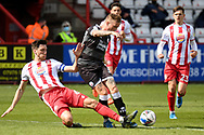 Stevenage defender Luke Prosser (6) battles for possession with Crawley Town forward (on loan from Leyton Orient) Jordan Maguire-Drew (34) during the EFL Sky Bet League 2 match between Stevenage and Crawley Town at the Lamex Stadium, Stevenage, England on 1 May 2021.