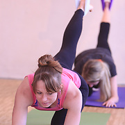 Harmony Hitchner, left, and Colleen Casey   participate in an Aerial Yoga class at Salty Dog Yoga Sunday April 6, 2014 in Carolina Beach, N.C. (Jason A. Frizzelle)