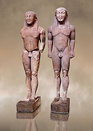 Kouros Statues of the Archaic Period. Early 6th c. B.C. (circa 580 B.C.)  Known as Kleovis and Biton, the two boys who heroically pulled their mother on her chariot to the sanctuary where she was to worship. They pulled the chariot for a distance of about 8km. They died the same night peacefully in their sleep according to Herodotus. Delphi Archaeological Museum. .<br /> <br /> If you prefer to buy from our ALAMY STOCK LIBRARY page at https://www.alamy.com/portfolio/paul-williams-funkystock/greco-roman-sculptures.html . Type -    Delphi     - into LOWER SEARCH WITHIN GALLERY box - Refine search by adding a subject, place, background colour, museum etc.<br /> <br /> Visit our ANCIENT GREEKS PHOTO COLLECTIONS for more photos to download or buy as wall art prints https://funkystock.photoshelter.com/gallery-collection/Ancient-Greeks-Art-Artefacts-Antiquities-Historic-Sites/C00004CnMmq_Xllw