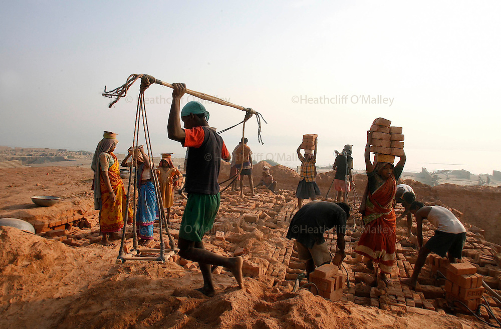 Photo by Heathcliff Omalley..Patna , Bihar, India 20 March 2007..A brick making factory on the bank of the river Ganges near the city of Patna, where men women and children work  for a minimum wage in Dickensian conditions making it a highly profitable business.