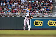 Pedro Florimon #25 of the Minnesota Twins makes a throw to 1st base against the Kansas City Royals on June 27, 2013 at Target Field in Minneapolis, Minnesota.  The Twins defeated the Royals 3 to 1.  Photo by Ben Krause