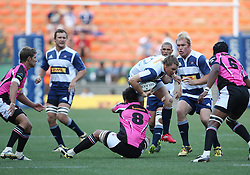 Jean de Villiers of the DHL Stormers takes on the Boland defense during the final warm-up match before the start of the Super Rugby season between the DHL Stormers and the Boland Cavaliers held at DHL Newlands Stadium in Cape Town, South Africa on 12 February 2011. Photo by Jacques Rossouw/SPORTZPICS