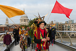 © Licensed to London News Pictures. 06/01/2019. London, UK.  The Holly Man, the winter guise of the Green Man joins actors from The Bankside Mummers group (the Lions part) to take part in a procession and play near the Globe Theatre in central London, in celebration of Twelfth Night, marking the end of the twelve days of winter festivities. Twelfth Night celebrations in the traditional agricultural calendar mark a last chance to make merry before returning to the rigours of work on Plough Monday.  Photo credit: Vickie Flores/LNP
