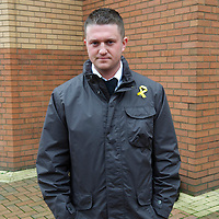 English Defence League (EDL) leader Tommy Robinson, also known as Stephen Lennon, poses for a portrait outside the West London Magistrates court, in Hammersmith on November 22, 2010.  Robinson has been charged with the assault of a police officer during an altercation with Muslim protestors in London.