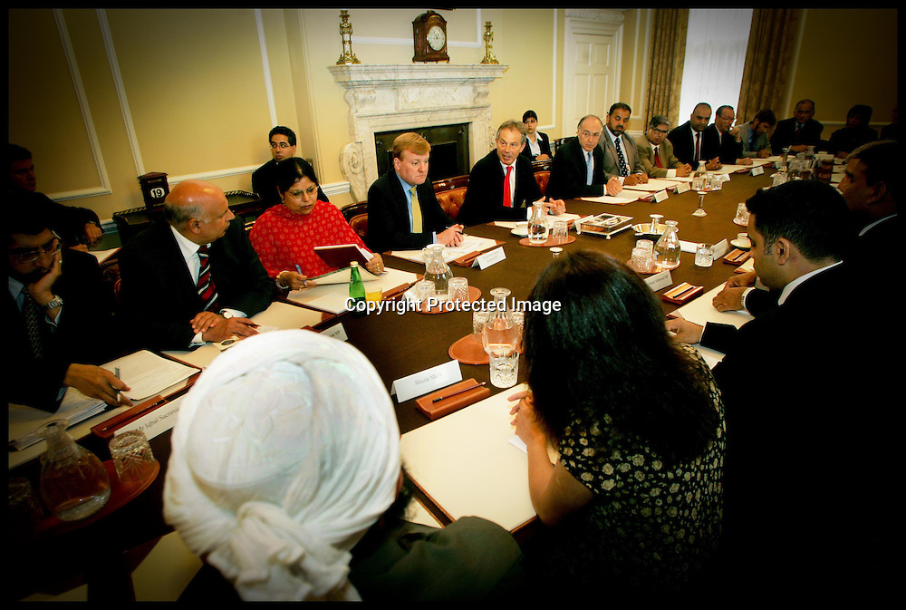 The British Prime Minister Tony Blair along with The Leader of the Liberal Democrats Charles Kenndy (Left) and leader of the Conservatives Michael Howard during a meeting in Downing St with UK Muslim Leaders.PA Photo Andrew PArsons.POOL: