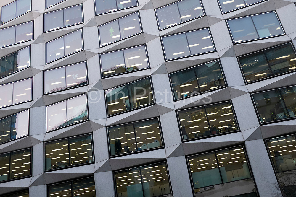 Graphic exterior of a buillding in the City of London, UK. This is 1980s architecture at it's best, utilising angular pieces of granite with glass, though it looks dated now.