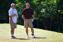 Kirby Smart talks to his caddie during the Chick-fil-A Peach Bowl Challenge at the Oconee Golf Course at Reynolds Plantation, Sunday, May 1, 2018, in Greensboro, Georgia. (Dale Zanine via Abell Images for Chick-fil-A Peach Bowl Challenge)