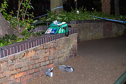 © Licensed to London News Pictures. 13/05/2020. London, UK. A medical pack sits on a wall above a pair of shoes on the ground inside a cordon on Vicarage Crescent where police found two injured men. Police were called at around 1800BST on Wednesday, 13 May, to reports of a man with a knife in Lombard Road, SW11. There were also reports of a car in collision with a wall in Lombard Road. Officers attended the location and found two men injured - one had cuts to his arms and the other cuts to his legs. Officers believed the two men had been travelling in the car. Both have been taken to hospital, where their injuries are not believed to be life-threatening. Investigations at the scene led officers to Vicarage Crescent, SW11, where they found two other injured men. Both were taken to hospital with non life-threatening injuries. Photo credit: Peter Manning/LNP