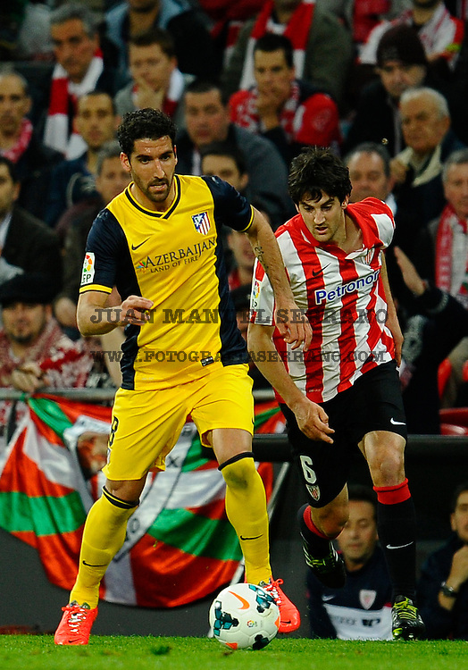 BILBAO, SPAIN - MARCH 29:  Raul Garcia of Atletico de Madrid competes for the ball with Mikel San Jose of Athletic Club during the La Liga match between Athletic Club de Bilbao and Club Atletico de Madrid at San Mames Stadium on March 29, 2014 in Bilbao, Spain.  (Photo by Juan Manuel Serrano Arce/Getty Images)