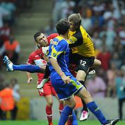 Turkey's Burak YILMAZ (L) and Kazakhstan's goalkeeper Aleksandr MOKIN (R) during their UEFA EURO 2012 Qualifying round Group A soccer match Turkey betwen Kazakhstan at TT Arena Istanbul September 02, 2011. Photo by TURKPIX