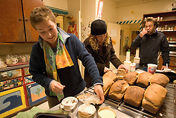 Stanford after dark. Stanford sophmore Katherine Roubos bakes and breaks bread with Jess Steinberg (jr) and Jon Elden (sr) at Columbay co-op.