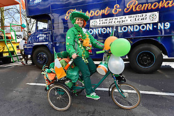 A performer riding a bicycle takes part in the parade along Piccadilly to celebrate St. Patrick's Day in London, Britain, on March 13, 2016. EXPA Pictures © 2016, PhotoCredit: EXPA/ Photoshot/ Ray Tang<br /> <br /> *****ATTENTION - for AUT, SLO, CRO, SRB, BIH, MAZ, SUI only*****