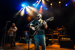 "© Licensed to London News Pictures. 01/07/2013. London, UK.   Zac Brown Band performing live at Shepherds Bush Empire. Zac Brown Band is Grammy award winning American country/folk band based in Atlanta, Georgia. The lineup consists of Zac Brown (lead vocals, guitar), Jimmy De Martini (fiddle, vocals), John Driskell Hopkins (bass guitar, vocals), Coy Bowles (guitar, keyboards), Chris Fryar (drums), Clay Cook (guitar, keyboards, mandolin, steel guitar, vocals), and Daniel de los Reyes (percussion).  in 2013 the band won a Grammy for Best Country Album with ""Uncaged"", and since forming they have earned a total of 55 award nominations & won 7 from the Grammys, Academy of Country Music, American Music Awards, Country Music Association and Country Music Television. Photo credit : Richard Isaac/LNP"