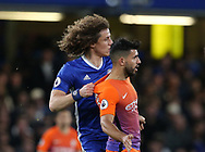 Chelsea's David Luiz tussles with Manchester City's Sergio Aguero during the Premier League match at the Stamford Bridge Stadium, London. Picture date: April 5th, 2017. Pic credit should read: David Klein/Sportimage