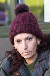 """Tracy, 49, a rough sleeper of several years on her pitch outside McDonalds on the High Street opposite Windsor Castle. After a public outcry against their """"homelessness support strategy"""" where rough sleepers would have been fined £100, Windsor council has shelved their plans. Windsor, Berkshire, February 16 2018."""