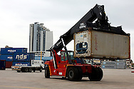 DURBAN - 28 March 2012 - A reach stacker lifts a container at Durban's RORO terminal. The terminal will handle containers while the main container terminal is upgraded..Picture: Giordano Stolley/Allied Picture Press/APP