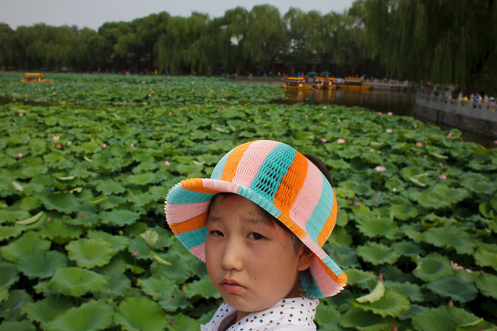 A girl with a colorful hat at Behai Park, in Beijing, China