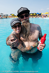 Jon and Pinky Barwood at the Broken Spoke County Line pool during the 78th annual Sturgis Motorcycle Rally. Sturgis, SD. USA. Thursday August 9, 2018. Photography ©2018 Michael Lichter.