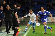 Cardiff City's Marouane Chamakh (r) chases the ball while being challenged by Sheffield Wednesdays Daniel Pudil (c). EFL Skybet championship match, Cardiff city v Sheffield Wednesday at the Cardiff city stadium in Cardiff, South Wales on Wednesday 19th October 2016.<br /> pic by Carl Robertson, Andrew Orchard sports photography.