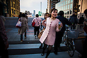 TOKYO, JAPAN, 9 APRIL - Nakameguro - A young woman run to see the cherry blossom with a beer in the hand. She wear a pink coat, the same color as the flowers - april 2012 [FR] Une jeune femme cours pour traverser la rue et voir les cerisiers en fleurs de la riviere Meguro. Elle porte une veste rose identique au couleur des sakura