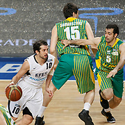 Efes Pilsen's Kerem TUNCERI (L) and Olin Edirne's Fikret Can AKIN (R) during their Turkish Basketball league match Efes Pilsen between Olin Edirne at the Sinan Erdem Arena in Istanbul Turkey on Friday 06 May 2011. Photo by TURKPIX