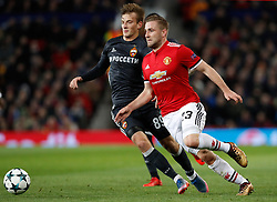 CSKA Moscow's Konstantin Kuchaev (left) and Manchester United's Luke Shaw in action during the UEFA Champions League match at Old Trafford, Manchester.