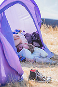 The last morning and people begin to pack but for others it is  the usual lie-in - The 2018 Latitude Festival, Henham Park. Suffolk 15 July 2018