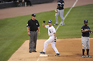 CHICAGO - JUNE 07:  Omar Vizquel #11 of the Chicago White Sox reacts after hitting a triple against the Seattle Mariners in the third inning on June 7, 2011 at U.S. Cellular Field in Chicago, Illinois.  The White Sox defeated the Mariners 5-1.  (Photo by Ron Vesely)  Subject:  Omar Vizquel