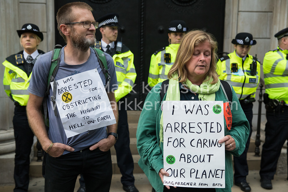 Extinction Rebellion climate activists call for Andrew Bailey, Governor of the Bank of England, to come out to speak with them on the eleventh day of their Impossible Rebellion protests on 2nd September 2021 in London, United Kingdom. The activists included over fifty wearing signs indicating that they were breaking restrictive bail conditions by entering the City of London. Extinction Rebellion are calling on the UK government to cease all new fossil fuel investment with immediate effect.