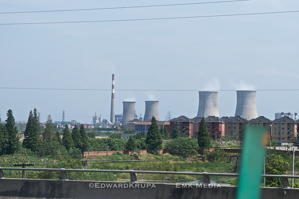 Nuclear power plant beside homesand highway. Taken from a van in China.
