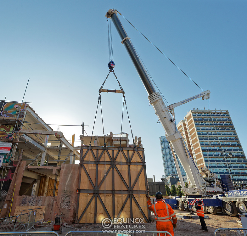 London, United Kingdom - 20 September 2019<br /> EXCLUSIVE SET - Aerial construction specialists and demolition experts use a huge crane to carefully lift intact, a twenty five ton, two-story wall, to preserve a famous Banksy rat image which has been covered up for years. Teams from specialist companies have spent over six weeks cutting around the artwork and fitting custom made eight ton steel supports to enable them to save the historic piece of art. Work has started on the construction of a new twenty seven floor art'otel hotel on the site of the old Foundry building in Shoreditch, east London, and a condition of the planning permission was to preserve the historical Banksy graffiti. A second section of the painting, an image of a TV being thrown through a broken window has already been cut out and moved separately. After the hotel construction is complete the two parts of the Banksy painting will be displayed on the hotel. Our pictures show the stages of work to protect the image, culminating in the lifting of the three story wall by crane. Video footage also available.<br /> (photo by: EQUINOXFEATURES.COM)<br /> Picture Data:<br /> Photographer: Equinox Features<br /> Copyright: ©2019 Equinox Licensing Ltd. +443700 780000<br /> Contact: Equinox Features<br /> Date Taken: 20190920<br /> Time Taken: 16571505<br /> www.newspics.com