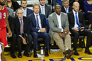 Golden State Warriors head coach Steve Kerr watches a NBA preseason game against the Los Angeles Clippers from the bench in the third quarter at Oracle Arena in Oakland, Calif., on October 4, 2016. (Stan Olszewski/Special to S.F. Examiner)