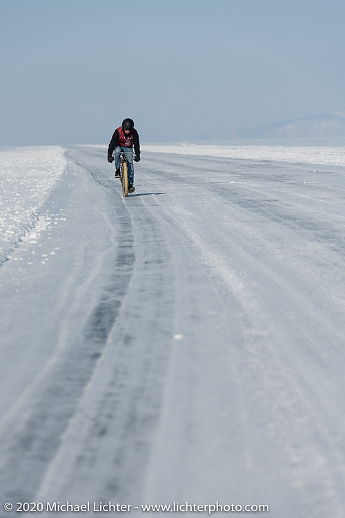 Alexander Propovednik racing his bicycle in the Baikal Mile Ice Speed Festival. Maksimiha, Siberia, Russia. Friday, February 28, 2020. Photography ©2020 Michael Lichter.