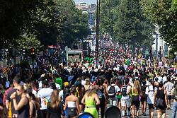 A view of the tens of thousands of revellers on Ladbroke Grove with Day two of the Notting Hill Carnival in West London in full swing, as performers floats form the procession in what is known as Europe's biggest Street Party. London, August 26 2019.