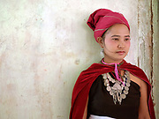 Portrait of a Kayah ethnic minority woman at a village wedding day on 22nd March in Kayah State, Myanmar. In the past most people residing in Kayah State were traditional spirit worshippers, but significant numbers have converted to Christianity, especially  Baptists or Catholics