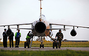 A Libyan airforce pilot walks next to his Mirage F1 fighter jet after landing at Malta International Airport outside Valletta February 21, 2011.  Two military jets reached Malta from Libya after flying in under radar cover, according to sources..Photo by Darrin Zammit Lupi