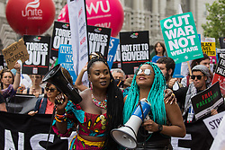 London, UK. 26th June, 2021. Marvina Newton (l) and Chantelle Lunt (r) join thousands of people attending a United Against The Tories national demonstration organised by the People's Assembly Against Austerity in protest against the policies of Prime Minister Boris Johnson's Conservative government. The demonstration contained blocs from organisations and groups including Palestine Solidarity Campaign, Stand Up To Racism, Stop The War Coalition, Extinction Rebellion, Kill The Bill and Black Lives Matter as well as from trade unions Unite and the CWU.