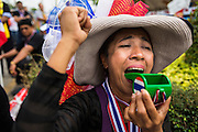 15 FEBRUARY 2014 - BANGKOK, THAILAND: An anti-government protestor blows a giant whistle at the Chaeng Watthana stage of the anti-government Shutdown Bangkok protests. The protests, organized by the  People's Democratic Reform Committee (PDRC), have tried to shutdown the Thai capital but crowds at the venues are getting smaller and police have taken back a couple of protest sites.     PHOTO BY JACK KURTZ