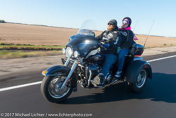 Pat Schock (Army Reserves) of the Old Cronies in Aberdeen, SD and his wife Angie on their Harley-Davidson Tri Glide in the USS South Dakota submarine flag relay across South Dakota. Groton, SD. USA. Sunday October 8, 2017. Photography ©2017 Michael Lichter.