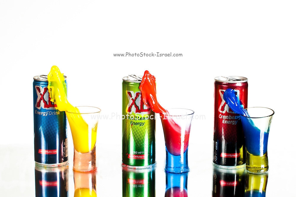 Colourful energy drinks pouring into glasses. Stop motion High-Speed photography technique