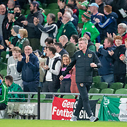 DUBLIN, IRELAND:  October 12:  A happy Stephen Kenny, head coach of the Republic of Ireland after a goal from Callum Robinson#7 of Republic of Ireland during the Republic of Ireland V Qatar International friendly match at Aviva Stadium on October 12th, 2021 in Dublin, Ireland. (Photo by Tim Clayton/Corbis via Getty Images)