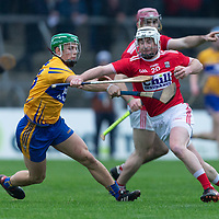 Cork's William Kearney pushes off Clare's Gary Cooney