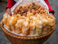 Asia, Vietnam, Hanoi, old quarter, traditional fried dough snacks on sticks