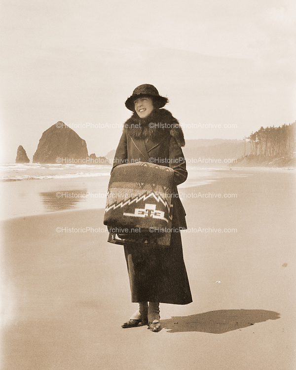 Cannon Beach from Tolovana. The woman is holding a blanket made by the Oregon City Woolen Mills. The blanket pattern was called Big City Lights, made  from 1922 to 1931