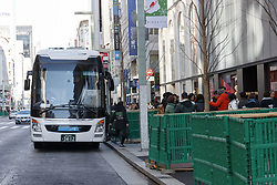 December 18, 2018 - Tokyo, Japan - A tourist bus is seen at Chuo-dori (the main shopping street) in Ginza. This year the number of foreign tourists visiting Japan is expected to exceed 30 million for the first time ever, said on Friday, the Japanese tourist agency. The government has set a target to attract 40 million overseas tourists in 2020, the year of the Tokyo Olympic Games. (Credit Image: © Rodrigo Reyes Marin/ZUMA Wire)