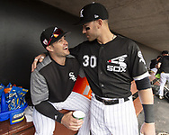GLENDALE, ARIZONA - MARCH 02:  Eddy Alvarez #91 (L) and Nicky Delmonico #30 of the Chicago White Sox joke around in the dugout prior to the game against the Colorado Rockies on March 2, 2019 at Camelback Ranch in Glendale Arizona.  (Photo by Ron Vesely)  Subject:  Eddy Alvarez; Nicky Delmonico