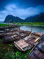 NINH BINH, VIETNAM - CIRCA APRIL 2019:  Rowing boats over the Van Long Nature Reserve and Wetlands near Ninh Binh.
