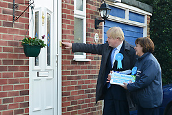 © Licensed to London News Pictures. 20/02/2013. Eastleigh, UK Boris Johnson and Maria Hutchins ring a doorbell of a property. London Mayor and member of the Conservative Party, Boris Johnson, and Conservative Candidate Maria Hutchins campaigning in the Eastleigh By-Election today 20th February in Stamford way, Eastleigh. Photo credit : Stephen Simpson/LNP