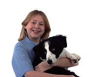 Young girl, cuddling puppy border collie dog, 12 years old, studio, white background, cut out, pet, domestic, smiling