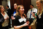 Office of the Chaper 13 Trustee Case Administrator Joanna Buda (center) talks with Northeastern Illinois University MBA student Katarzyna A, Turkiewicz (right) during a reception announcing the formation of the Jan Karski Educational Foundation on Monday, November 12th at the law offices of Baker & McKenzie LLP. Born in 1914, Karski was a member of the Polish Underground, a World War II resistance movement in occupied Europe. His undercover dispatches offered allied nations significant insight into Nazi atrocities, later detailed in his book Story of a Secret State and earning him a posthumous President Medal of Freedom in 2012. A team of Baker & McKenzie lawyers in Chicago and Warsaw helped to create the non-profit Foundation. © 2012 Brian J. Morowczynski ViaPhotosMorowczynski ViaPhotos